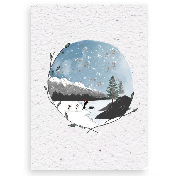 Kerstkaart op groeipapier pinguïns op het ijs